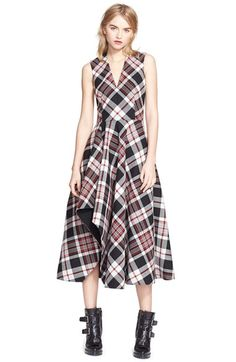 Free shipping and returns on Alexander McQueen Plaid Fit & Flare Midi Dress at Nordstrom.com. Exploded plaid is expertly pieced at an angle to highlight the dramatically flowing silhouette of this midi-length wool dress. Darts nip in the V-neck bodice above a seamed natural waist, while an artfully cut skirt cascades in a stunning ruffle to expose a hint of leg at every step.