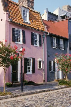 """CHARLESTON, SOUTH CAROLINA In 1931, an affluent judge and his wife bought a section of houses in this historic city and painted them pastel. Their neighbors followed suit, leading to a street dubbed """"Rainbow Row"""" and many other colorful moments sprinkled throughout the historic city."""