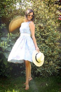 Pale lilac vintage dress with straw hat.