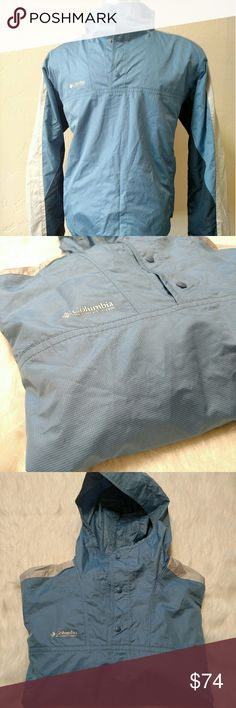 Columbia windbreaker jacket blue packable Medium Used but good condition windbreaker.  Zipper pockets, baby blue main color, hoodie, button front near neck. Columbia Jackets & Coats Windbreakers