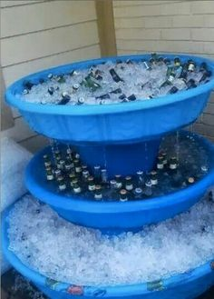 Have kiddie pools collecting dust? Turn them into party beverage cooler fountain