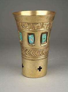 Rattle Beaker  Date:     10th–11th century Geography:     Peru, La Leche River Culture:     Sicán (Lambayeque) Medium:     Gold, turquoise