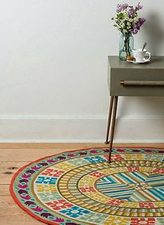 Highlighting a space with a round rug. See more tips for decorating with round rugs