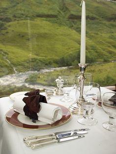 Elegant dining table aboard The Royal Scotsman train.
