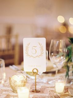 """I like how it has the wreath with the number in it, and then """"table five"""" underneath"""