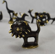 Mixed Lot of Bosse Animal Figures & An Ashtray Design: Walter Bosse & Herta Baller  Lion Marked, Bosse Austria.  Height: 4cm  Elephant Unmarked. (Attr. Bosse) Height: 4cm  Aquarius/Posiden Unmarked. (Attr. Bosse) Height: 4cm  Giraffe Unmarked. (Attr. Bosse) Height: 8.5cm Giraffe has some scartches!  Galloping Horse 1 Unmarked. (Attr. Bosse) Height: 4cm  Galloping Horse 2 Unmarked. (Attr. Bosse) Height: 4cm  Doe Umarked. (Attr. Bosse)  Height: 5cm (from tip of ear)  Cat Unmarked. (Attr…