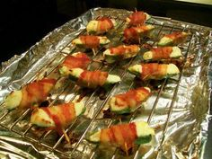 Jalapeno Poppers Ingredients: 6 fresh jalapeno peppers, halved lengthwise and seeds removed 1 (8 ounce) package cream cheese 1 pkg dry Ranch Dressing 12 slices bacon Directions: Preheat an outdoor...