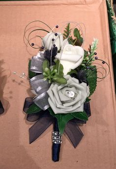 Ladies navy, Ivory & silver buttonhole. Made by me for my daughters wedding.