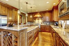 I absolutely love the look of these golden, wooden cabinets. My wife and I have been planning on remodeling our kitchen. I definitely feel like some new cabinets could go a long way.