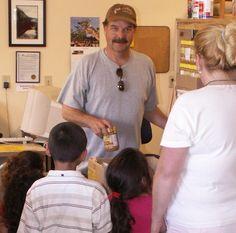 A Volunteer helps fill a food basket