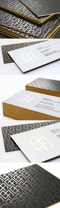 Sleek Foil Embossed Black And White Business Card Design