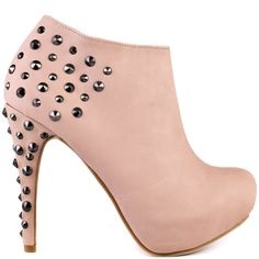 Add a brave and daring accessory to your outfit with these rockstar booties.  Magneto by Promise showcases a nude faux leather upper with a collection of edgy studs placed at the back and 4 1/2 inch heel.  Want some more height to this bold style? Than the 1 inch hidden platform will you give you a small lift!
