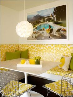 Photo courtesy of Palmer Weiss Interior Design A happy breakfast nook in yellow and white features built in banquette seating with a playful. Kitchen Banquette, Banquette Seating, Dining Nook, Kitchen Nook, Dining Table, Booth Seating, Kitchen Seating, Booth Table, Table Bench