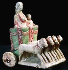 Brightly colored model of a four-horse chariot with a woman and a child on board. Etruscan.