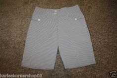 "New without tags Nike Golf Womens Dri Fit Gray Stripe Flat Front  Shorts Size 8  Has two front pockets and two back pocket and button and zip closure  Colors are white and gray with yellow and yellow swoosh  95% Polyester and 5% Spandex  Waist 31"" Inseam 10"" and from waist to hem 19 1/2""    International customers email for shipping cost.    100% Satisfaction Guaranteed, and Fast Shipping."