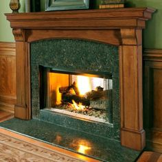 incredible fireplace mantels ideas with brown wooden mantel and green granite surround also combine with picture frames with fireplace mantels images and