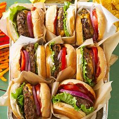 Whiskey Barrel Burgers..Classic grilled hamburgers get even better when stuffed with a gooey cheddar cheese filling.