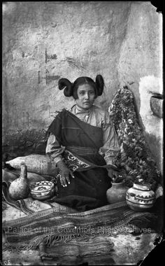 """Young Hopi woman with squash blossom hairstyle, """"Moqui Girl of Walpi Pueblo, Arizona Territory"""" Photographer: Ben Wittick Date: 1880? Negative Number 002595"""