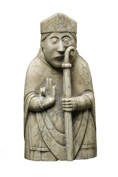 Lewis Chessmen Bishop: is standing whilst giving a blessing with his right hand. On his head he wears a mitre and holds a crosier in his left hand.