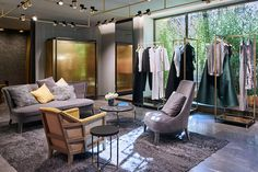 1000 m2 over 3 floors, soft lights and a contemporary mood define a pure and unique design for the Max Mara Old Bond Street store in London.