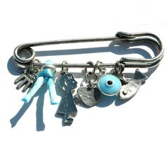 Baby pin protection charm... pin it on your child's stroller or near your child's bed to ward off the evil eye.