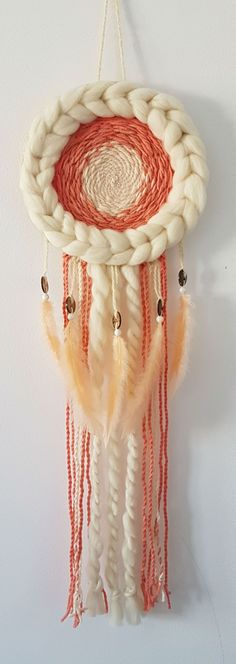 Wall hanging dream catcher with merino yarn, natural wool yarn, orange feathers, brown and white beads. You can use it for decorating your home, garden, yoga studio, wedding or any other special event. This modern dreamcatcher will add a bohemian touch to any space. The design is unique! Ready to ship! #dreamcatcher #bohohomedecor #homedecor #handmade #etsy