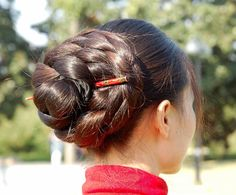 Jin Mei with  big braided bun. Beauty is at every age, and we can embrace God's gifts. A wife's long hair is just naturally beautiful, a glory to her and a joy to her partner/husband. Quit trying the artificial route and trust in how you were made.