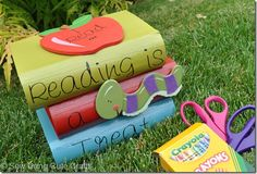 "This would be a cute gift... each ""book"" opens up. You could put candy in one, stickers in one, and maybe bookmarks in the other? and give it to the teacher to reward students for reading!"