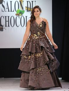 Chocolate fashion show in Paris. Marion Bartoli wears a creation with a draped sweetheart strapless neck and tiers all made with chocolate during a fashion show at the inauguration of the 19th annual Salon du Chocolat in Paris on October 29, 2013. The show, the world's biggest dedicated to chocolate, brings together fashion designers and chocolatiers from around the world. UPI/David Silpa.