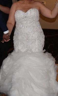 We have beaded plus size wedding gowns at Darius Cordell #Fashion Ltd. Let our US dress design firm recreate this strapless bridal gown for you in any size or with any changes. Fit-and-flare #weddingdresses are popular.  We can make a custom one specific to you.  (We also offer inexpensive replicas of couture dresses)  Get pricing on any picture and more details at www.dariuscordell.com