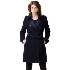 This classic, double-breasted trench coat is tailored to fit the feminine silhouette.