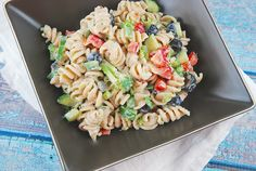 Checkout this easy Summer Pasta Salad Recipe at LaaLoosh.com! It's flavorful, filling, is and perfect for your next Weight Watchers summer side dish recipe.