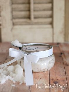 Coconut Sugar Scrub: Take 1 cup of white sugar and mix in 1/4 c. coconut oil in a bowl.  It will take a few minutes for the sugar and oil to completely combine.  Be patient and mix thoroughly with the back of a spoon. Use on your hands, elbows, heels etc. Great gift in a pretty jar with a ribbon (printable label link for the lid at bottom of article)