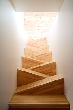 """Staircase - """"this is a low budget project made out of stacked boxes of pine. The cut out between the ground floor and the attic was too narrow to construct a regular stair."""""""