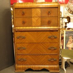 SOLD $275. Vintage antique art deco waterfall chest of drawers / dresser c. 1930. Book matched veneer, original Bakelite hardware, carved trim. Wonderfully detailed piece that would be right at home in any bedroom. Very good condition.