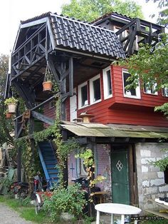 """the Christiania """"hardware store"""" (in Denmark), a three story barn which features hundreds of racks and shelves full of recycled wood, windows, appliances, handmade furniture and other building materials!"""