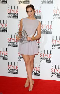 """Emma Watson ✾ 2011 — Wearing 'Hakaan,' Emma poses w/ the award for """"Style Icon"""" she received at the """"ELLE"""" Style Awards in London."""