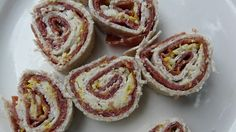 1. Salami Pinwheels: This variation on a sandwich takes no time to make. Just lay a tortilla on a board, cover the bottom with salami, or ham, or any other type of cold meat your child enjoys, add some mustard, a bit of grated cheese. Then roll them up and slice them into pinwheels that are fun to eat.