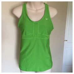 """♣️ Nike dri-fit bright green sports bra tank top M This is a Nike dri-fit neon green tank top. Has built in bra. Made of polyester and spandex. It'll make you stand out. Racerback Design. Whether you're out for a run or at sports practice, the Nike Dri-Fit Long Sport Sleeveless Training Top-Bright Green is essential for your active lifestyle. Size medium.   All items are from a clean, smoke free home  We ❤️ offers but will only be considered by using the """"OFFER"""" option  Trades  Modeling Nike…"""