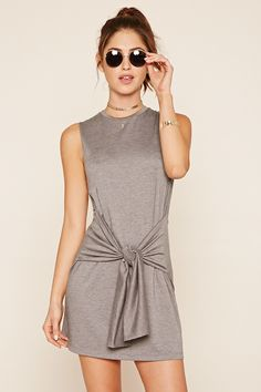 A heathered knit mini dress featuring a self-tie front, sleeveless cut, and a round neckline.