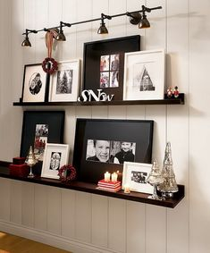 Galley wall. Eclectic pieces. Shelves!!!! & sign , frames of a few different colors instead just black or just white.