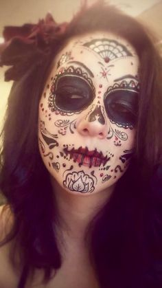 Sugar Skull makeup that I did a few years ago for Halloween. I won a killer costume contest with it!