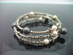 pretty cool set of tutorials - swarovski Pearl Memory Wire Bracelet tutorial http://www.beadworldinc.com/Downloads.html
