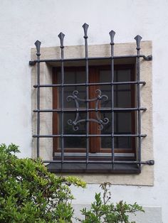Small window in a residential with solid iron protection grid