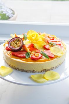 Raw Mango and Passionfruit Summer Celebration Cake. Total summery yumness - mango, passionfruit, papaya, coconut and lime. All vegan, refined sugar free.