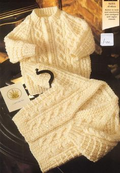 Pattern to knit 2 sweaters/cardigans to fit chest sizes 17.5 inches to 24.5 inches Uses 8 ply yarn DK Light WWeight Aran/Fishermans Sweaters SIZING: Premature 12/14 ins up to 4.5 lbs. Birth 16/17 ins - 7.5 lbs. 3 months 18 ins - 11.5 lbs. 6 months 19 ins - 16 lbs. 9 months 19.5 ins - 18 lbs. 12 months 20 ins - 20 lbs. 18 months 21 ins 24 months 22 ins 3 years 23 ins 4 years 24 ins NO RESALE RIGHTS - in accordance with Etsys policies