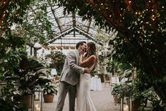 Bride and groom portrait inside greenhouse venue | Image by Emma Quinn