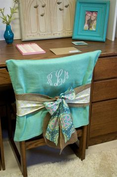 handmade monogrammed chair covers (make solid cover and change out ribbon for different seasons and holidays)