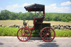 1896 Roberts Electric Stanhope- C. E. Roberts of Chicago Steel Screw Co. was an inventor that created this automobile make. This cas has two 2-hp motors directly driving the rear axles. The leather-lined brakes were inside the motor housings. The Stanhope body style was marked by a single bench seat in the middle of the body....not also, the tiller steering. This car gets the same mileage off it's batteries as the Chevy Volt if not the speed!