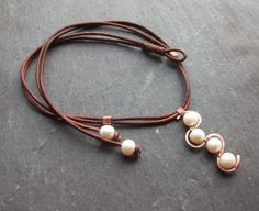 Something a little bit different for a chic beach look !! Featuring 4 freshwater pearls on a hand forged copper wave, hanging on a double